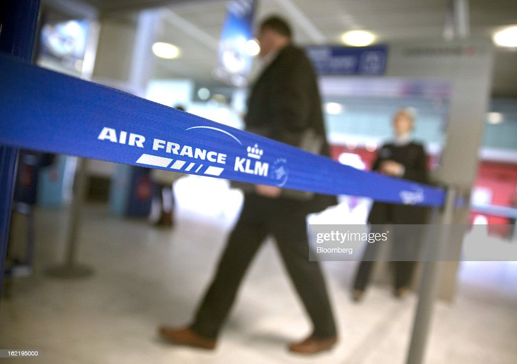 A passenger enters the Air France-branded check-in area, part of the Air France-KLM Group at Toulouse-Blagnac airport in Toulouse, France, on Tuesday, Feb. 19, 2013. Air France-KLM, Europe's biggest airline, has been revamping its regional operations in an effort to end years of losses. Photographer: Balint Porneczi/Bloomberg via Getty Images