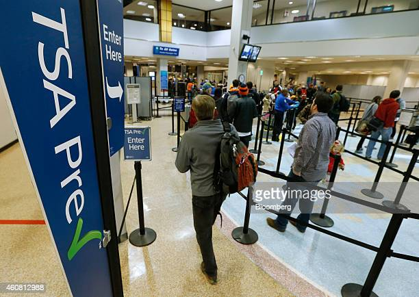 A passenger enters the Transportation Security Administration precheck line towards a security check point at Salt Lake City International Airport in...
