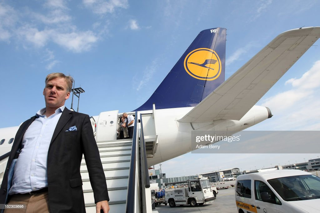 A passenger exits a Lufthansa airplane on September 14, 2012 at Frankfurt International Airport (Fraport) in Frankfurt, Germany. After the latest in a series of Lufthansa cabin crew strikes led by the flight attendants' union UFO, actions demanding guarantees for job security as well as a five percent salary increase, resulting in nearly 1,800 flight cancellations after 13 months of contract negotiations, the strikers and the airline have agreed upon a former economic adviser to the German government, Bert Ruerup, as an arbitrator, who has stated that he expects a solution by the end of October. The cabin crew union has agreed not to strike over the estimated six weeks of discussions.