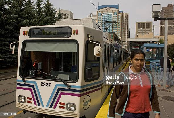 A passenger exits the Calgary Light Rail commuter train as seen in this 2009 Calgary Canada morning city landscape photo