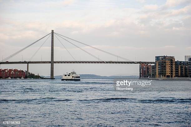 A passenger ferry approaches the city bridge as it heads towards Hundvag island in Stavanger Norway on Tuesday March 4 2014 Norwegians debt burden...