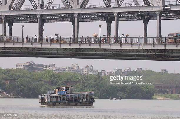 Passenger ferry under Howrah Bridge, Kolkata, West Bengal, India, Asia