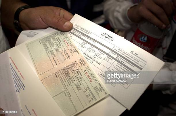Passenger Holds His Visa And Tickets To Board Flight 8529 From Los Angeles To Havana Cuba At Los Angeles International Airport April 15 2000 Taca...