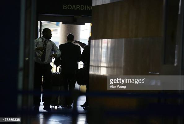 A passenger is given with direction to board an Acela Express Train at a gate at Union Station May 18 2015 in Washington DC Amtrak has restored its...