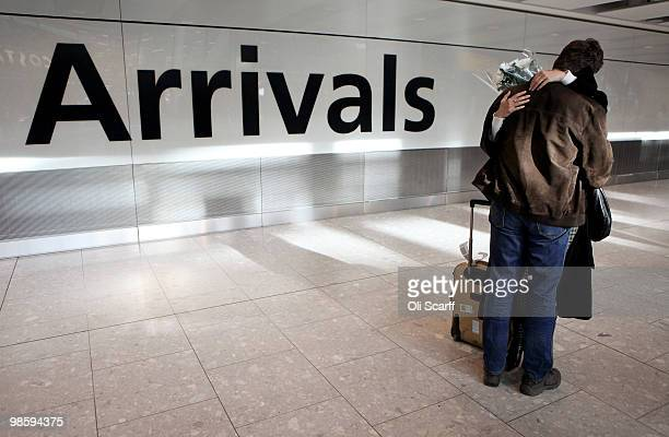 A passenger is greeted in the arrivals lounge of Heathrow airport's Terminal 5 on April 21 2010 in London England Airlines are beginning to resume a...