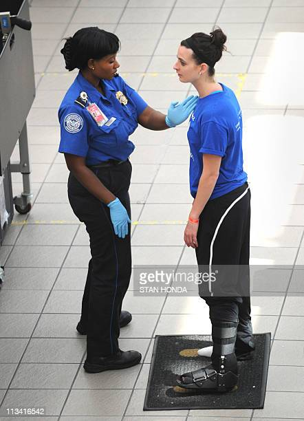 A passenger is patted down by a Transportation Security Administration agent May 2 2011 at Orlando International Airport in Orlando Florida Security...