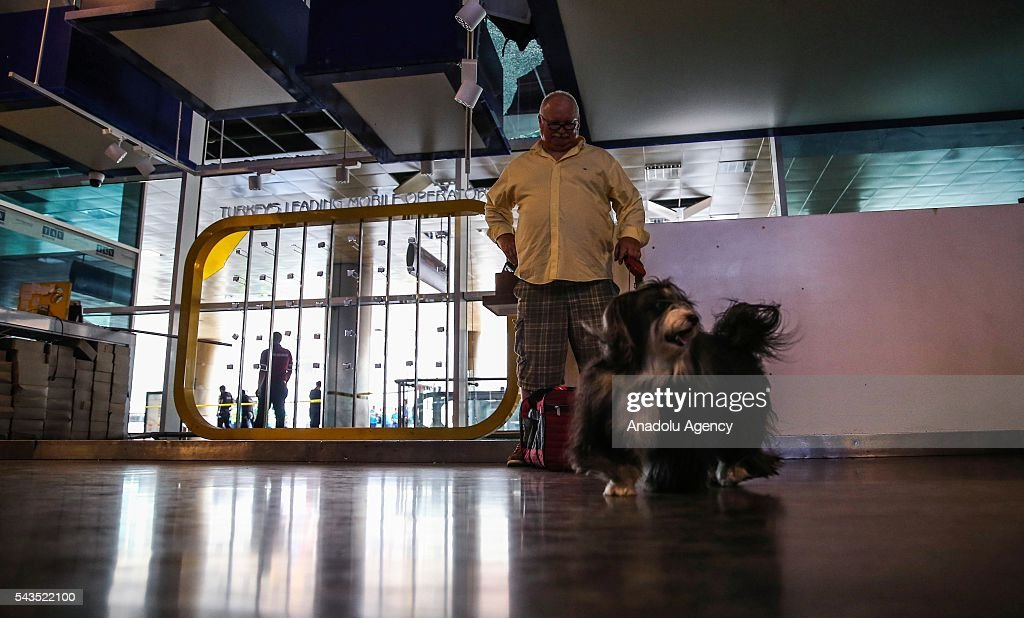A passenger is seen with his dogs at the Ataturk International Airport after the air traffic returned to normal following yesterday's terror attack in Istanbul, Turkey on June 29, 2016. At least 36 victims and three suicide bombers were killed while scores of others were injured in a terror attack on Istanbuls Ataturk International Airport.
