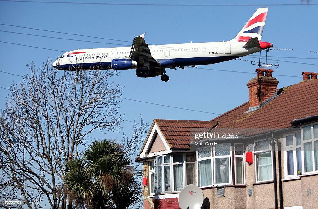 A passenger jet aircraft comes into land at Heathrow Airport on March 13 2007 in London England Emmissions from aircraft are a major contribution to...