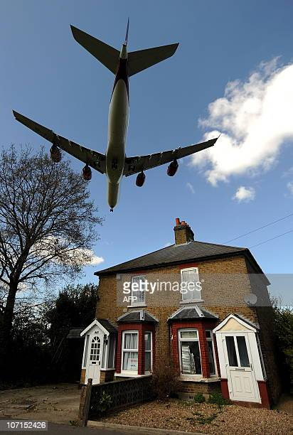 A passenger jet flies over houses as it prepares to land at Heathrow Airport in west London on April 21 2010 Flights took to Europe's skies in...