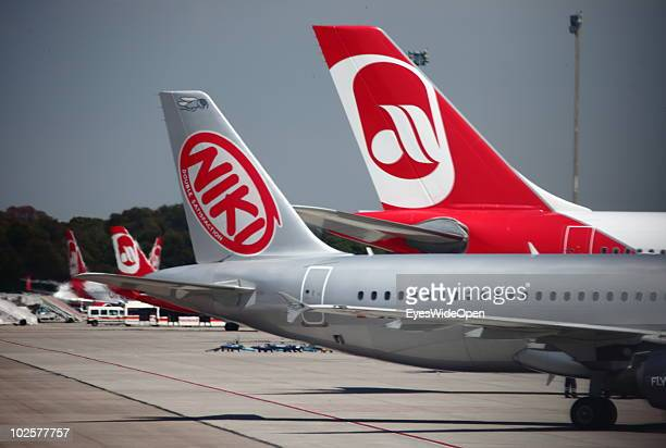 A passenger jet from the Austrian airline NIKI a partner of the German airline Air Berlin sits on the tarmac after landing at the airport on May 25...