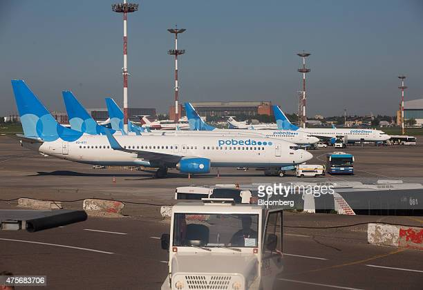 Passenger jets operated by Pobeda Airlines a lowcost unit of Aeroflot Russian Airlines OJSC stand on the tarmac at Vnukovo International airport in...