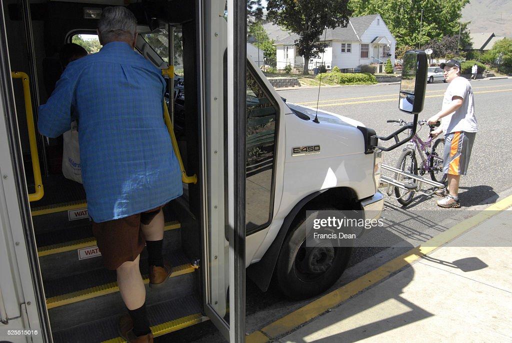 Passenger loading bike at comunity bus transport 15 May 2012