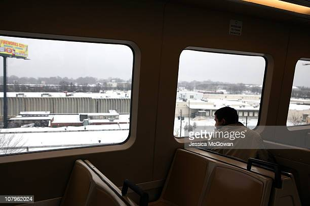 A passenger looks at the view from a Marta train after a snow storm on January 10 2011 in Atlanta Georgia Atlanta Mayor Kasim Reed and Georgia...