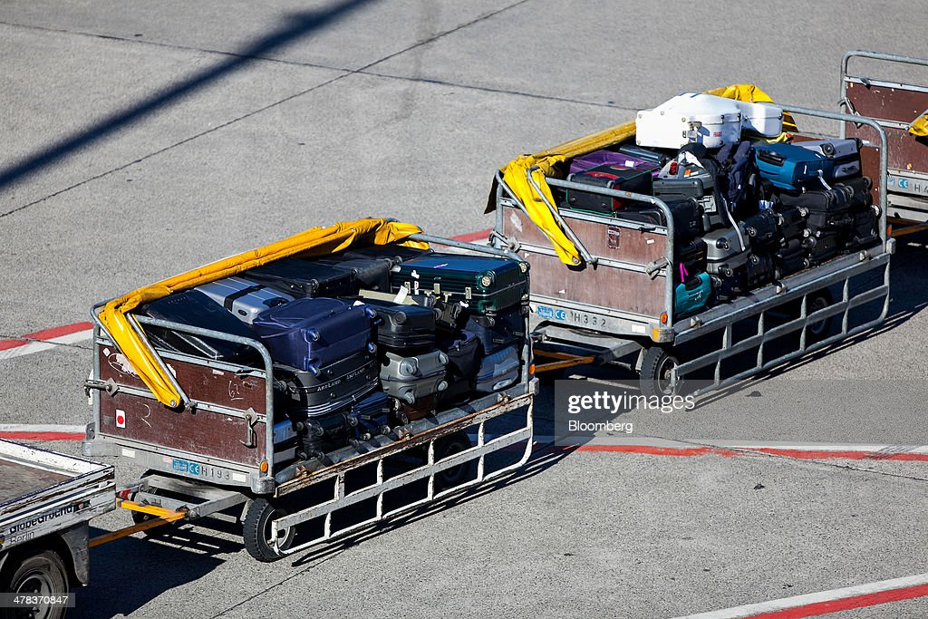 Passenger luggage sits in trailers on the tarmac at Tegel airport, operated by Flughafen Berlin Brandenburg GmbH, in Berlin, Germany, on Wednesday, March 12, 2014. Berlin's Tegel airport has subsisted by chance alone, defying the odds as passenger growth outpaces every other major hub in Western Europe. Photographer: Krisztian Bocsi/Bloomberg via Getty Images