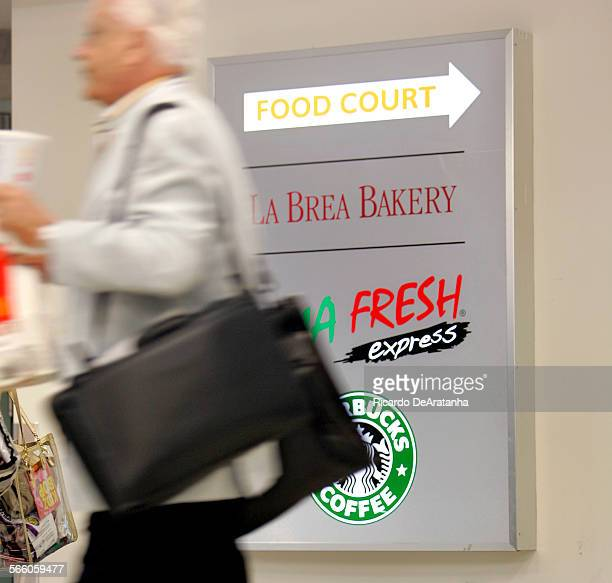 A passenger passing by a FOOD COURT sign at Los Angeles International Airport LAX concession area in terminal 7 May 5 2009 The food court will be...