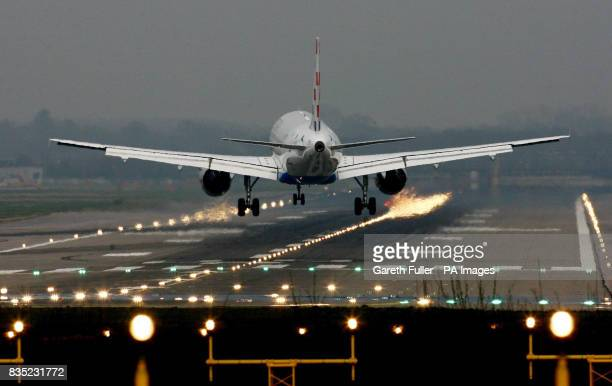 A passenger plane lands at Gatwick Airport in West Sussex as BAA are forced to sell the site and break their monopoly on airport sites across the UK