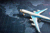 Passenger plane on the world map.Business transportation system concept
