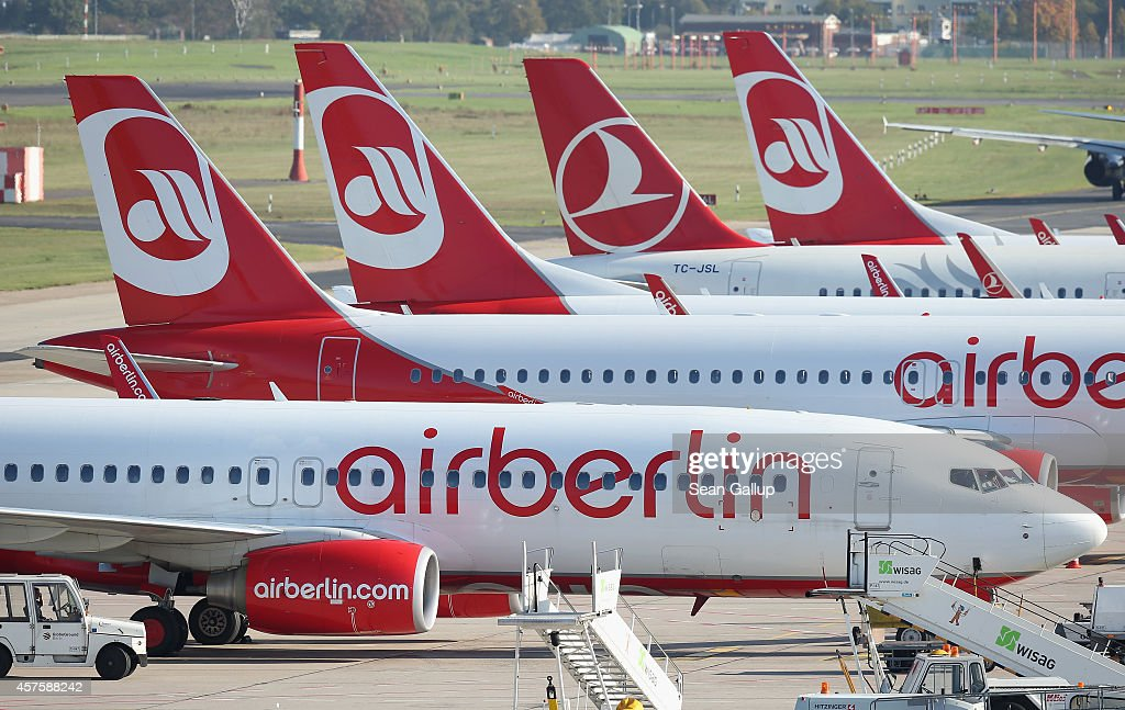 Passenger planes of German airliner Air Berlin as well as one of Turkish Airlines stand on the tarmac at Tegel Airport on October 21 2014 in Berlin...
