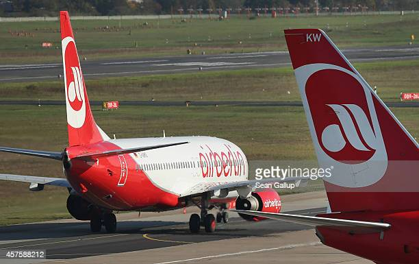 Passenger planes of German airliner Air Berlin stand on the tarmac at Tegel Airport on October 21 2014 in Berlin Germany Air Berlin is Germany's...