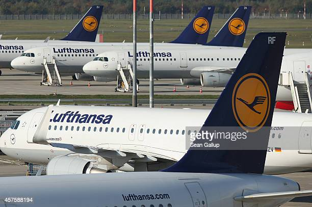 Passenger planes of German ariline Lufthansa stand parked on the tarmac at Tegel Airport during a twoday strike by Lufthansa pilots on October 21...