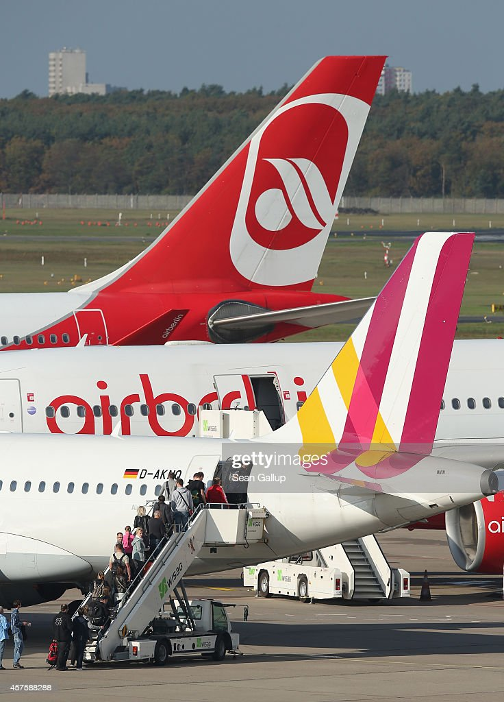 Passenger planes of Germanwings and Air Berlin stand on the tarmac at Tegel Airport on October 21 2014 in Berlin Germany The two are Germany's...