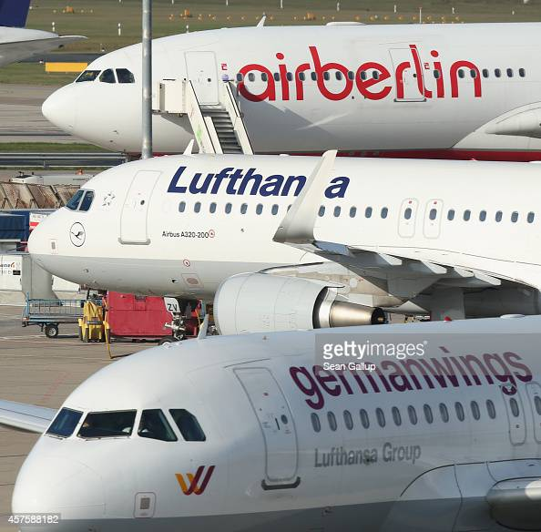 Passenger planes of Lufthansa Germanwings and Air Berlin stand on the tarmac at Tegel Airport on October 21 2014 in Berlin Germany The three are...