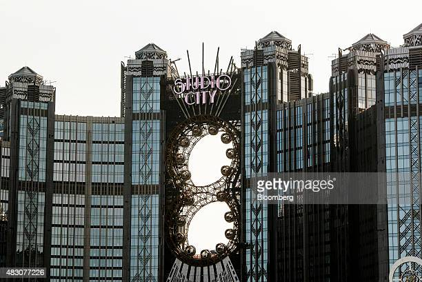 Passenger pods sit on Ferris wheels at the construction site of the Studio City casino resort developed by Melco Crown Entertainment Ltd in Macau...