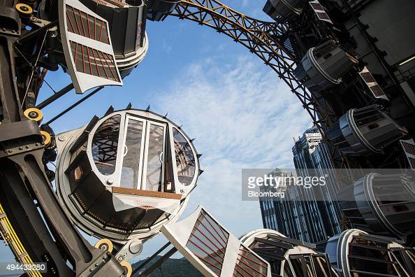 Passenger pods sit on the Golden Reel ferris wheel at Studio City casino resort developed by Melco Crown Entertainment Ltd in Macau China on Tuesday...