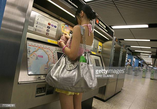 A passenger purchases a ticket for the Mass Transit Railways in Hong Kong 09 October 2007 Shares of Hong Kong's largest railway operator MTR...