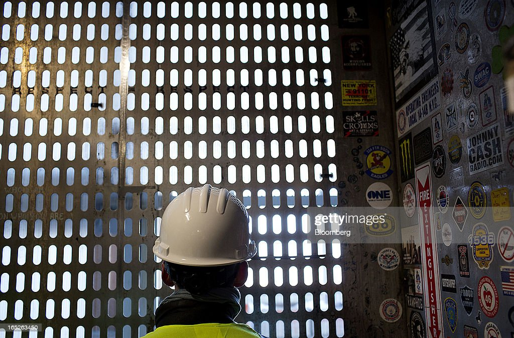 A passenger rides an elevator to the 100th floor of One World Trade Center during a media tour in New York, U.S., on Tuesday, April 2, 2013. The observation deck at One World Trade Center, expected to open in 2015, will occupy the tower's 100th through 102nd floors. Guests visiting the observation deck will see a 'pre-show' about the creation of the building while waiting in line in the lobby. Photographer: Victor J. Blue/Bloomberg via Getty Images