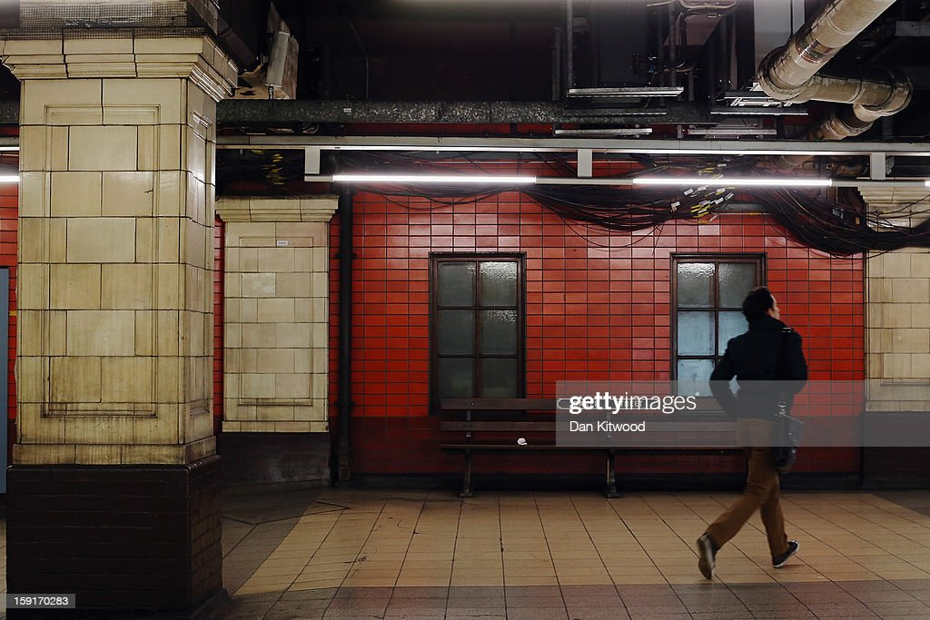 A passenger runs for a train at Baker Street Underground Station on January 9, 2013 in London, England. Baker Street Station shares the 150th Anniversary of its opening on January 10th, 2013 with the London Underground. Commonly called the Tube, the London Underground is the oldest of its kind in the world and now carries approximately a quarter of a million people around its network of 249 miles of track every day. Baker Street station was remodeled between 1911-13 by architect Charles W Clark to its present form as part of a comprehensive rebuilding project by the Metropolitan Railways with the station as its new company headquarters and flagship station, where it quickly became known as the 'Gateway to Metro - Land'. Outside the Marylebone Road exit, a large statue commemorates Sherlock Holmes, Sir Arthur Conan Doyles ficticious detective who resided in the novels at 221B Baker Street.