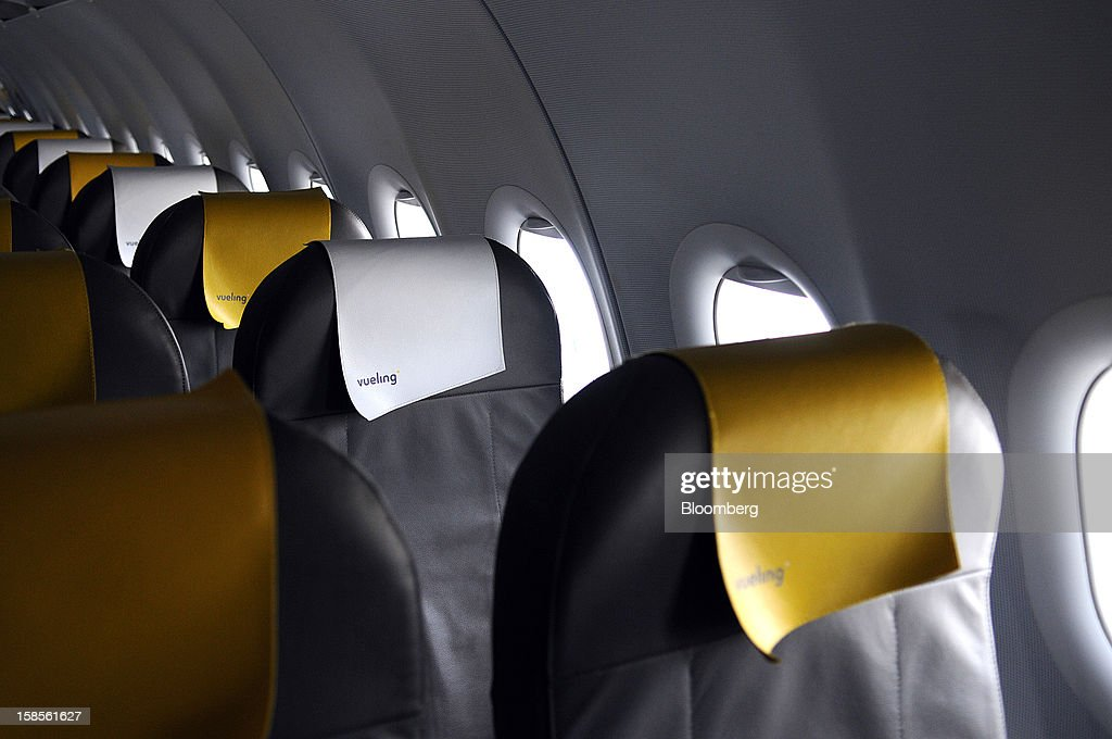 Passenger seats are seen on an Airbus A320 operated by Vueling Airlines SA at EL Prat airport in Barcelona, Spain, on Wednesday, Dec. 19, 2012. International Consolidated Airlines Group SA won't require European Union approval to buy 100 percent of low-cost carrier Vueling Airlines SA, the EU's antitrust chief said. Photographer: Stefano Buonamici/Bloomberg via Getty Images
