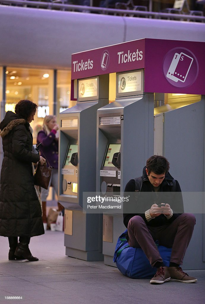 A passenger sits by a ticket machine at Kings Cross station on January 2, 2013 in London, England. Rail fares have today risen by an average of 4.2% in England, Scotland and Wales, the tenth year in a row that fares have increased above inflation.