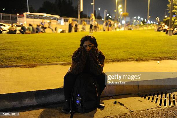A passenger sits dejectedly outside the Turkey's largest airport Istanbul Ataturk after the suicide bomb attacks June 28 Turkey Three suicide bombers...