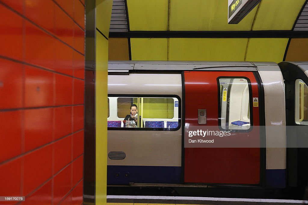 A passenger sits on a train at Baker Street Underground Station on January 9, 2013 in London, England. The London Underground commonly called the Tube, is the oldest of its kind in the world, and marks it's 150th anniversary on January 10, 2013. The network carries approximately a quarter of a million people around its network of 249 miles of track every day. The Baker Street station has more platforms than any other on the network with 10, and is one of the oldest of the 270 stations on the entire network.