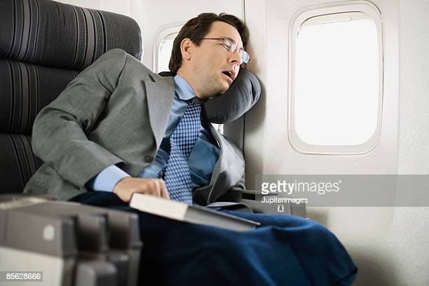 Passenger sleeping on airplane