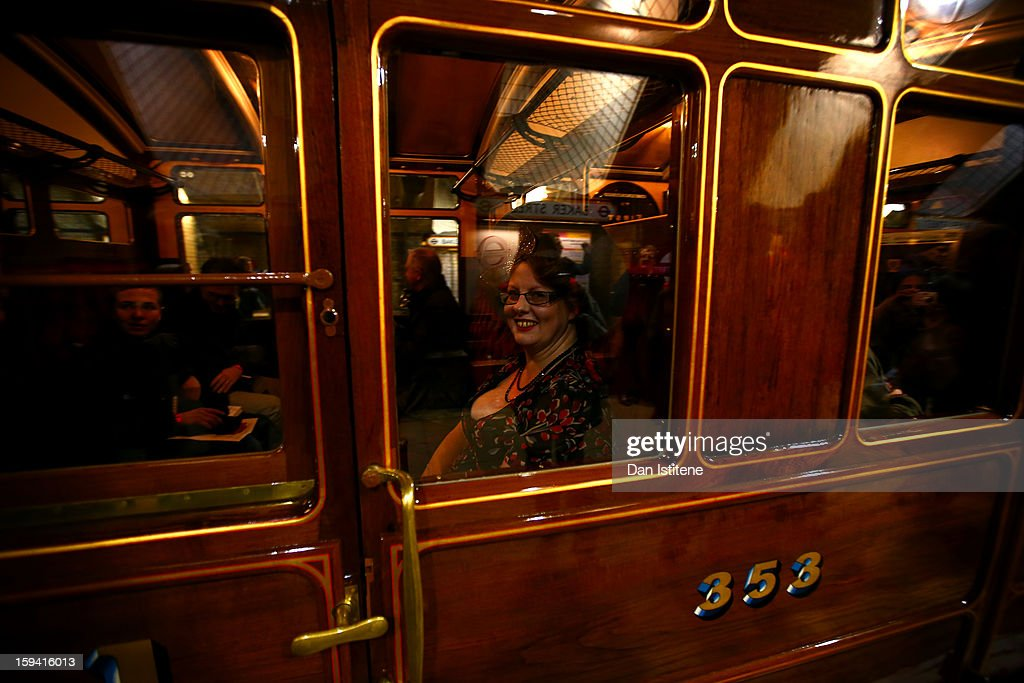 A passenger smiles as the newly restored steam engine built in 1898, known as Met Locomotive No. 1, arrives at Baker Street Underground station in a recreation of the first London Underground journey on January 13, 2013 in London, England. The London Underground celebrates its 150th birthday this month, the Metropolitan line being the first stretch between Paddington and Farringdon stations.
