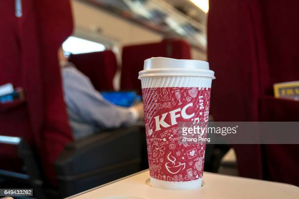 A passenger takes a KFC coffee on the train Yum China the operator of fastfood giants KFC Pizza Hut and Taco Bell in the country said operating...