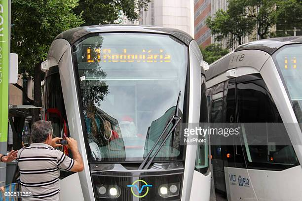 A passenger takes a picture at a driver of public bus disguised as Santa Claus in Rio de Janerio Brazil December 24 2016 Santa Claus driving a train...