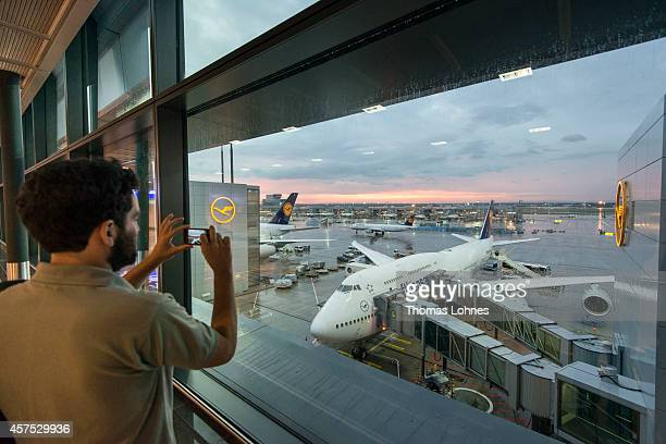 A passenger takes a picture of a Lufthansa airplaine at Frankfurt Airport on October 09 2014 in Frankfurt Germany Vereinigung Cockpit the labor union...