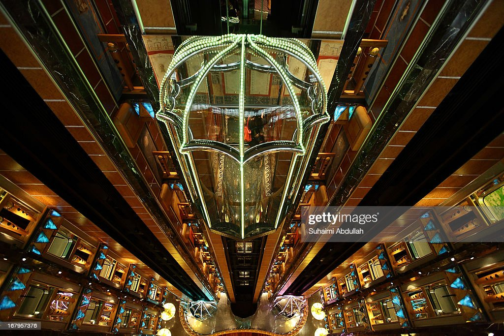 A passenger takes the lift at the atrium inside the Costa Atlantica at the Marina Bay Cruise Centre Singapore on May 3, 2013 in Singapore. Costa Atlantica made its maiden call to Singapore today and is the biggest ship in the Costa Cruises fleet to be deployed in the region. Costa is one of Carnival plc's 10 cruise brands.