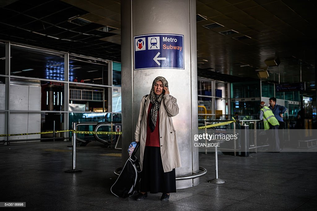 A passenger talks on her mobile phone on June 29, 2016 at Ataturk International airport in Istanbul, a day after a suicide bombing and gun attack targeted Istanbul's airport, killing at least 36 people. A triple suicide bombing and gun attack that occurred on June 28, 2016 at Istanbul's Ataturk airport has killed at least 36 people, including foreigners, with Turkey's prime minister saying early signs pointed to an assault by the Islamic State group. / AFP / OZAN