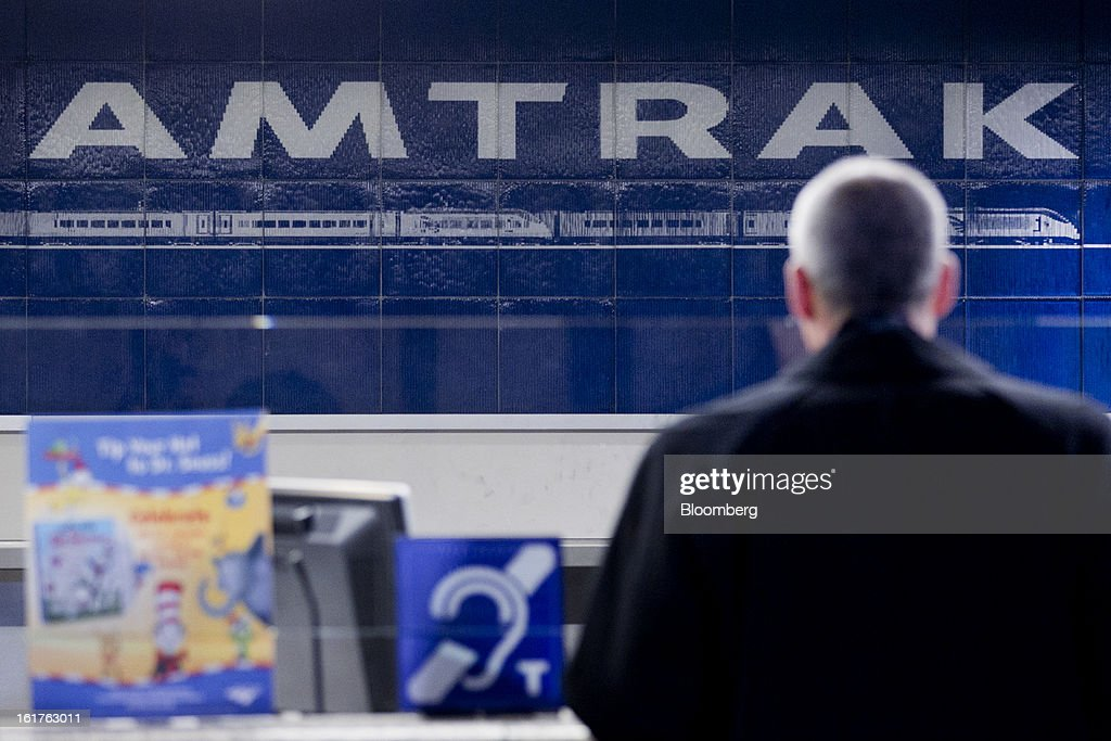 A passenger talks to an employee at the Amtrak Acela counter at Union Station in Washington, D.C., U.S., on Friday, Feb. 15, 2013. Amtrak, the U.S. long-distance passenger railroad and federally subsidized since its beginning 41 years ago, last month reported its lowest operating loss in nearly four decades, announcing the passenger rail company had reduced its total operating loss by 19 percent compared to the previous year. Photographer: Andrew Harrer/Bloomberg via Getty Images