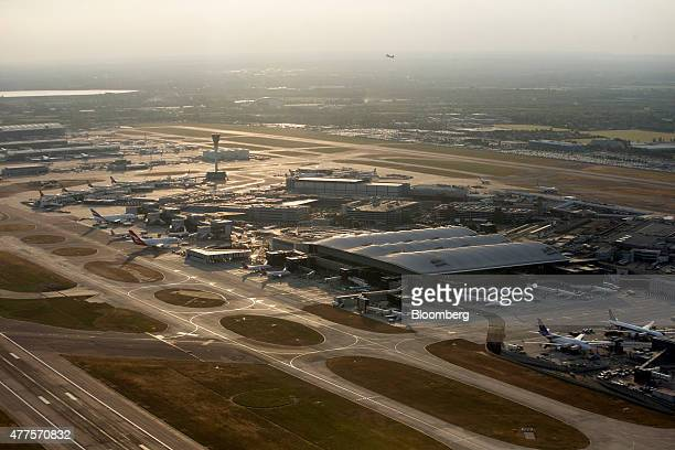 Passenger Terminals 1 and 3 sit between the airport's runways at London Heathrow Airport in this aerial photograph taken over London UK on Tuesday...