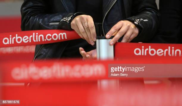 A passenger tightens an Air Berlin security belt at Tegel Airport on August 23 2017 in Berlin Germany Air Berlin's creditors are meeting to discuss...