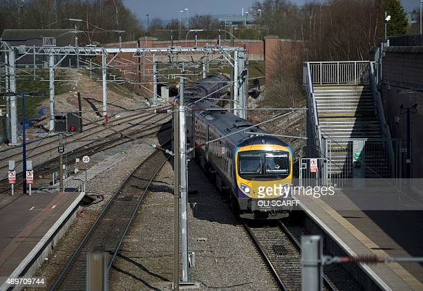 A passenger train arrives at the railway station adjoining Manchester Airport in Manchester in north west England on April 7 2015 As a general...