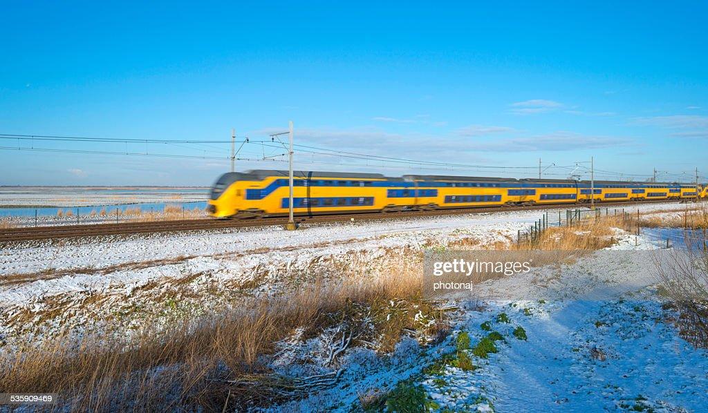Passenger train in a snowy landscape : Stock Photo