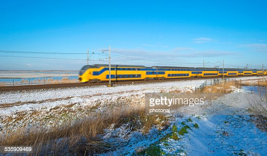 Passenger train in a snowy landscape : Stock Photo
