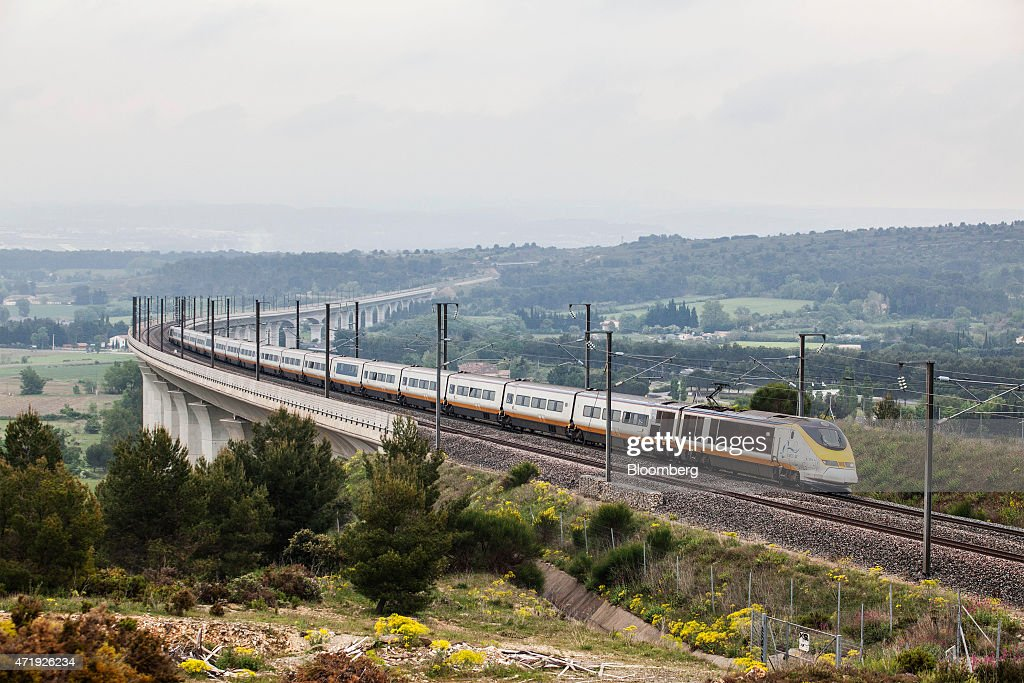 A passenger train operated by Eurostar International Ltd makes its inaugural return journey to London as Eurostar launch a new railway service...