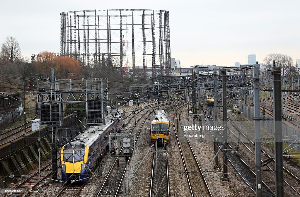 Passenger trains are seen on tracks outside Paddington railway station in London, U.K., on Thursday, Jan. 3 2013. Rail commuters have been hit by inflation busting fare increases of up to 10 per cent, adding hundreds of pounds to the cost of annual season tickets. Photographer: Chris Ratcliffe/Bloomberg via Getty Images